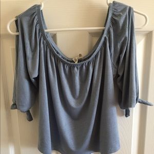An off shoulder peasant style blouse